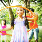 child playing with a hula hoop