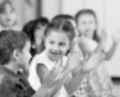 group of children clapping