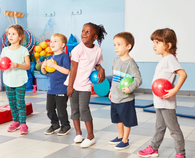 group of children holding a ball