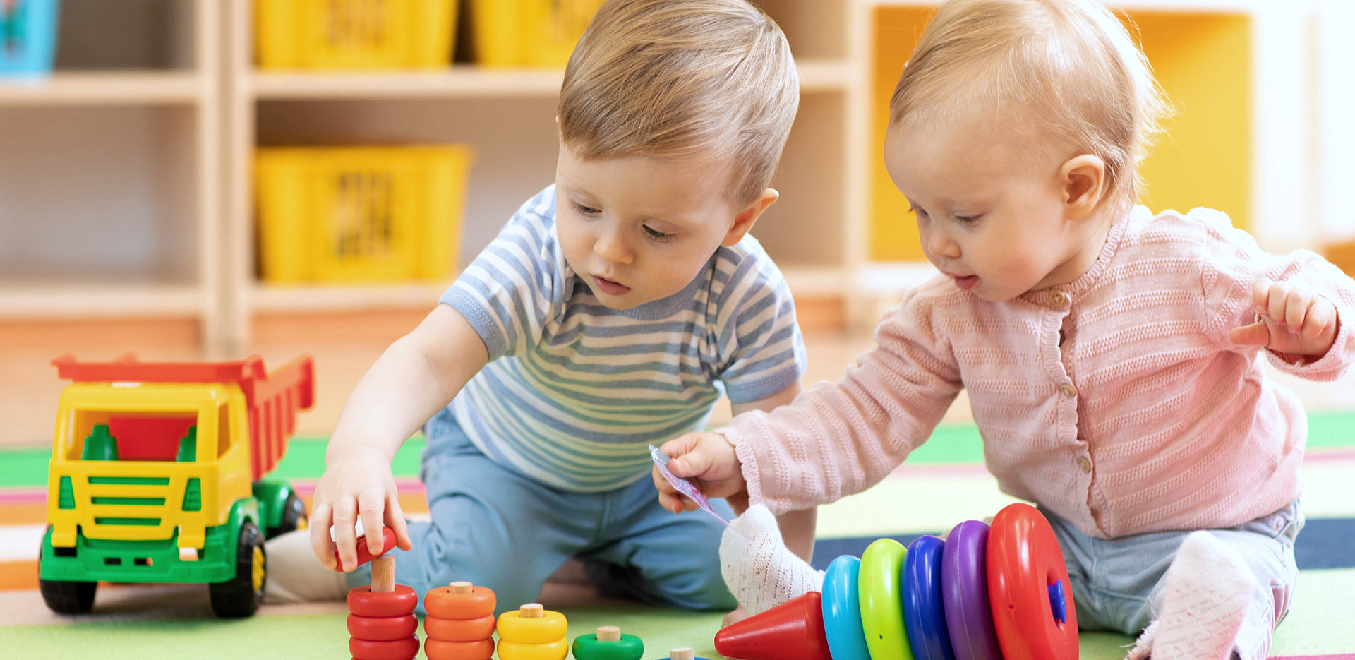 two children playing with toys