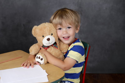 child hugging a bear toy